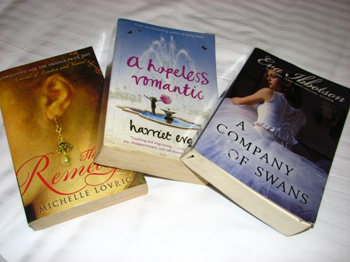 in my suitcase: The Remedy by Michelle Lovric, A Hopeless Romantic by Harriet Evans, A Company of Swans by Eva Ibbotson